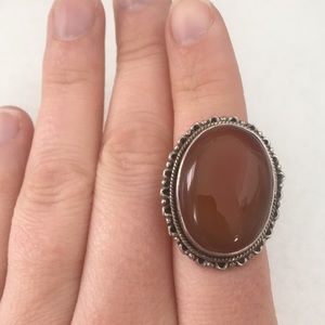 Jewelry - Metal cocktail ring with large orange stone